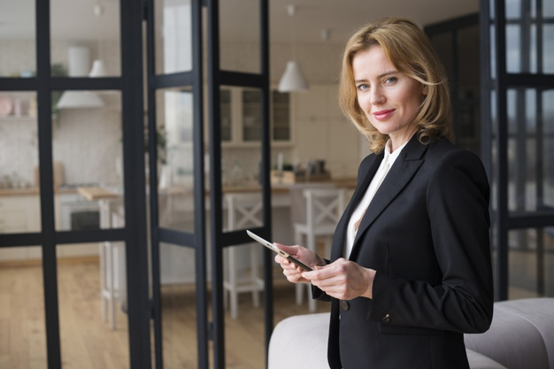 blond business woman using tablet